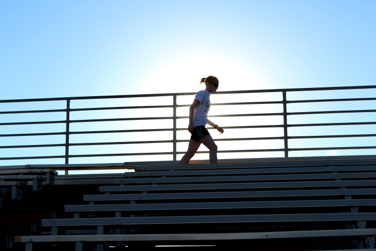 Crosby finishes running bleachers even though she has shin splints and has difficulty seeing with the bright sun. Because there is no pigment in her eyes, it lets in too much light, which is why she wears extra dark sunglasses.