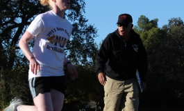 Crosby sets the pace for her teammates at practice behind University Stadium on a practice track.